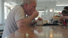 Man At Coffee Shop Bar Food Drinking Stock Footage