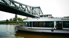 Tour Boat passing Eisener Steg bridge Frankfurt am Main Germany Europe Stock Footage