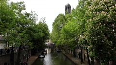 Pan: The Oudegracht old canal in center of Utrecht with cafes, restaurants Stock Footage