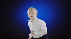 cute boy dancing on blue screen - stock footage