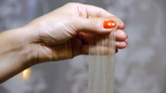 Female hand holding a condom with an iron key inside Stock Footage