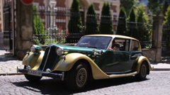 Street scene with retro car on sunny day in old city with great architecture Stock Footage