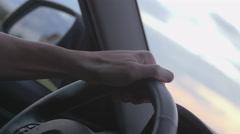 Hand on steering wheel Stock Footage