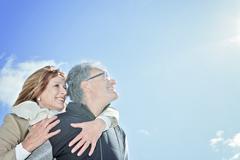 Portrait of happy senior couple in winter season - stock photo