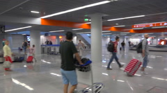 Baggage claim area in an airport arrival terminal - Warsaw Chopin, Poland - pan Stock Footage