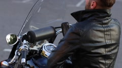 Biker Prepares to Take a Trip on His Motorcycle Stock Footage