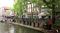 Tilt: The Oudegracht old canal in center of Utrecht with cafes, restaurants Stock Footage
