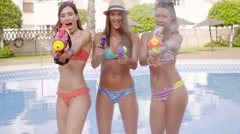 Three sexy girls with water guns Stock Footage