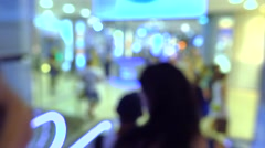 Blurred people using escalator in modern shopping mall. 4K bokeh video Stock Footage