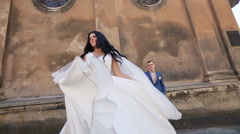 Happy beautiful emotional sexy brunette bride dancing with her dress and white Stock Footage