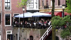 The Oudegracht old canal in center of Utrecht with cafes, restaurants Stock Footage