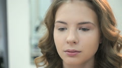 Beautiful model gets a professional makeup Stock Footage