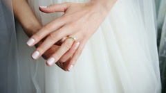 Bride in a beautiful white dress, hands with a wedding ring with a jewel close Stock Footage