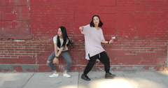 Young Asian woman dancing hip hop in city Stock Footage