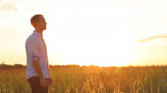 Romantic young couple is kissing on a sunset with sun shining bright behind Stock Footage