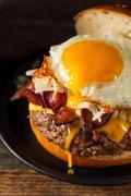 Homemade Breakfast Cheeseburger with Bacon Stock Photos