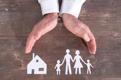 Family and house insurance concept Stock Photos