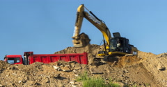Excavator and dump truck skill work on construction of new highway. Time lapse Stock Footage
