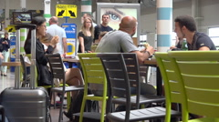Passengers having a lunch during stopover in an airport terminal - France Stock Footage