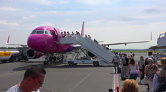 Passengers boarding on airliner - Beauvais airport tarmac, France - large Stock Footage