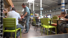 Snacking area in an airport terminal, passengers lunch time - Beauvais, France Stock Footage