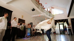 Newlyweds spinning at wedding dance to the applause of a large group of people Stock Footage