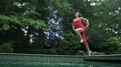 Carefree woman diving in pool Stock Footage