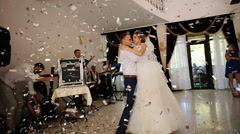 Newlyweds spinning at wedding dance to the applause of a large group of people - stock footage