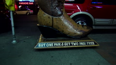 Huge western boots at Boots Country on Broadway in Nashville Stock Footage