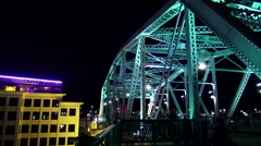 Illuminated pedestrian bridge over Cumberland River in Nashville Stock Footage