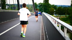 Group young people jogging Frankfurt am Main Germany Europe Stock Footage