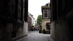 People pass under the Dom building in the ancient city center Utrecht Stock Footage