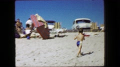 1959: Boy running away beach classic 1950s cars perfect blue sky day.  CAPE COD, Stock Footage