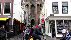 People pass near the Dom building in the ancient city center Utrecht Stock Footage