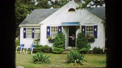 1959: Boy running out of quaint Americana style house towards camera. CAPE COD, - stock footage