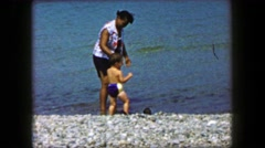 1959: African women caring caucasian boy babysitting multiracial relations. CAPE Stock Footage