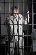 Female Prisoner in Jail - stock photo