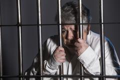 Female Prisoner in Jail - elderly woman - stock photo