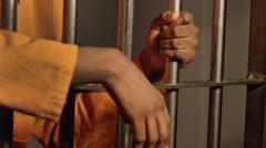 Man in Jail hands Stock Photos