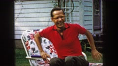1959: Middle aged successful eyeglasses nerd man relaxing in outdoor chair. CAPE - stock footage