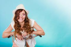 Active woman riding bike bicycle. Recreation. - stock photo