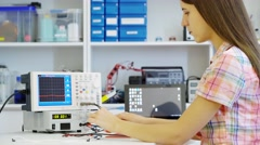 Girl solder and repair electronic device Stock Footage