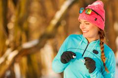 Fit girl in winter park - stock photo