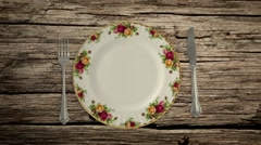 Empty Plate Knife and Fork on a Picnic Table in Stop Motion Stock Footage