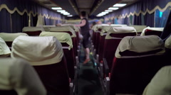 Interior of intercity bus passenger boarding the coach at night station terminal Stock Footage
