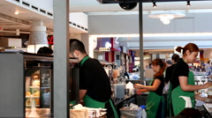 One side of barista working inside Starbucks store with 4k resolution. Stock Footage