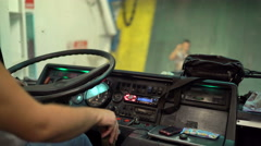 Bus driver driving intercity coach to load on car passenger ferry boat Stock Footage