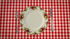 Empty Plate Knife and Fork on a Table Cloth in Stop Motion Stock Footage