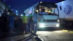 Passengers boarding a night bus route Yalta Krasnodar at Kerch strait ferry line Stock Footage