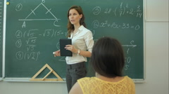 Clever confident female student in the classroom writing on a chalkboard math Stock Footage